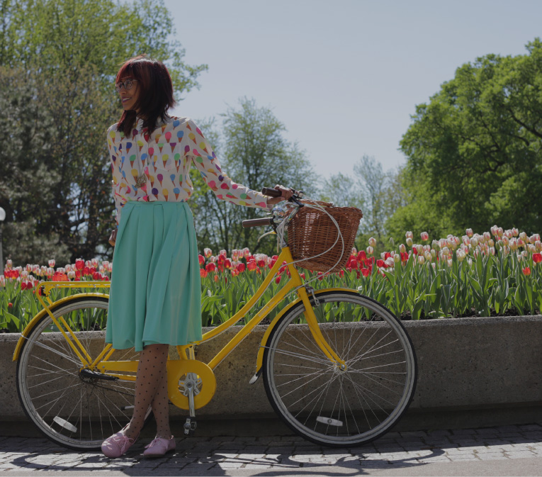 young woman taking a break from biking to enjoy the tulip festival