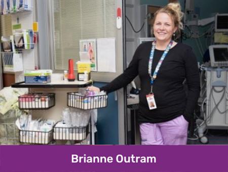 A nurse standing by a PPE cart.