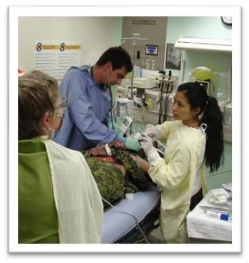 Practitioners assessing a patient.
